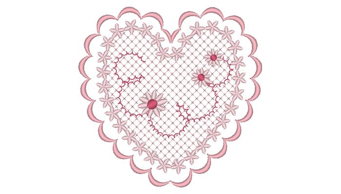 Motif de broderie coeur rose sur fond blanc