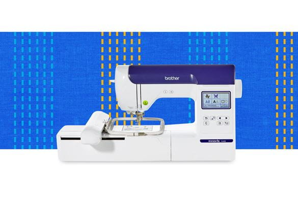 F440 embroidery machine on a dark blue pattern background