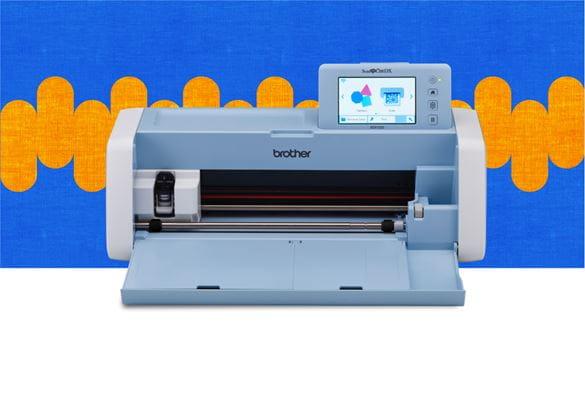 Плоттер ScanNCut DX1200 на сине-оранжевом фоне