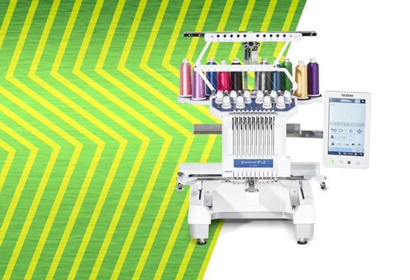 PR1055X embroidery machine on green zigzag background