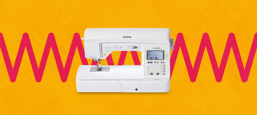 sewing machine on an orange and red pattern background