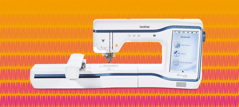 Brother Stellaire XE1 Embroidery machine on yellow and pink background