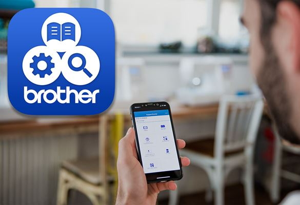 Gentleman holding mobile in hand and looking at Brother Support app