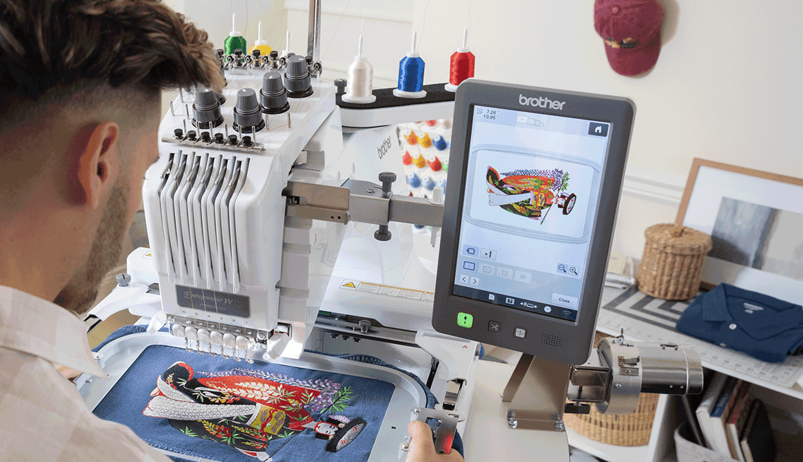 Man operating the PR680W embroidery machine
