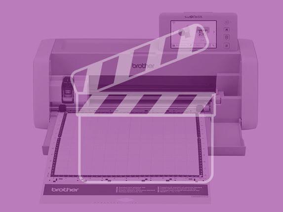 ScanNCut snijmachine met paarse filter en videosymbool