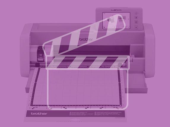 Elektron. Nähmaschine ScanNCut mit violetter Auflage und Videosymbol