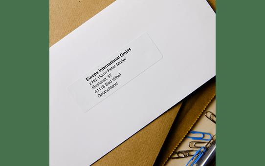 Oriģināla Brother DK-11201 uzlīmju lenta – melnas drukas, balta 29mm x 90mm 2