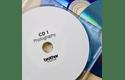 Rouleau d'étiquettes pour CD/DVD DK-11207 Brother original – Noir sur blanc, 58mm de diamètre. 2
