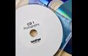 Originele Brother DK-11207 voorgestanst cd/dvd label – film - zwart op wit - diameter 58 mm. 2