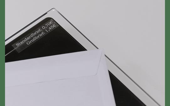 Original TZe-135 Schriftbandkassette von Brother – Weiß auf Transparent, 12mm breit 4
