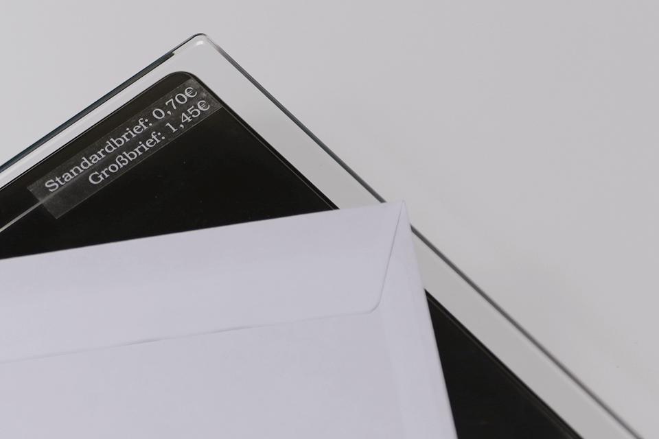 Fita laminada TZe135 Brother para envelopes