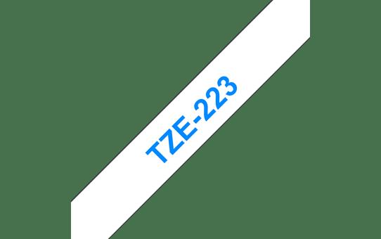 Original Brother TZe223 merketape – blå på hvit, 9 mm bred