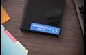 Genuine Brother TZe-555 - бял текст на синя ламинирана лента, ширина 24mm 4