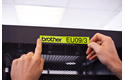 Casetă cu bandă de etichete originală Brother TZe-C51 – negru pe galben fluorescent, lățime de 24mm 4