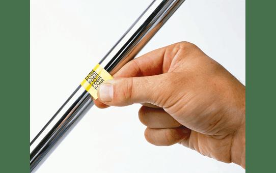 Eredeti Brother TZe-FX641 szalag sárga alapon fekete, 18mm széles 4