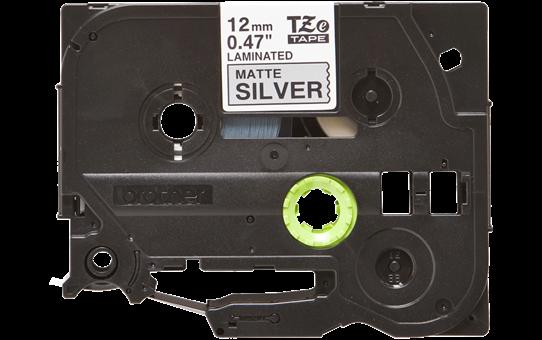 Oriģināla Brother TZe-M931 uzlīmju lentas kasete – melnas druka, matēta, sudraba, 12mm plata