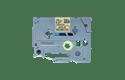 TZeMPGG31: оригинальная кассета с лентой для печати наклеек черным на золотистом фоне, ширина 12 мм.