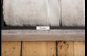 Oryginalna nielaminowana taśma TZe-N241 firmy Brother – czarny nadruk na białym tle, 18mm szerokości 4