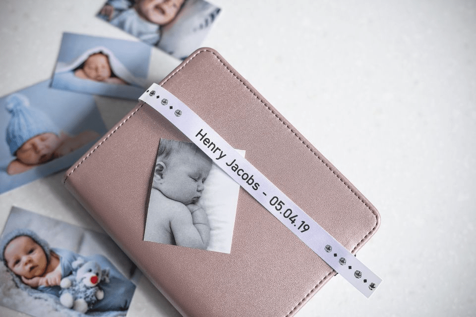 Brother TZe-R251 satin ribbon tape cassette - black on white - new born baby photo album with the name and date of birth of the baby