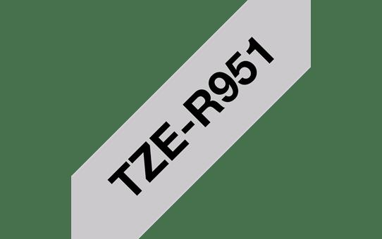 Oriģināla Brother TZe-R951 auduma lentes kasete – melnas drukas sudraba, 24mm plata 3