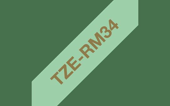 Oryginalna taśma wstążkowa Brother TZe-RM34  – złoty nadruk na jasnozielonym tle, 12 mm szerokości 3