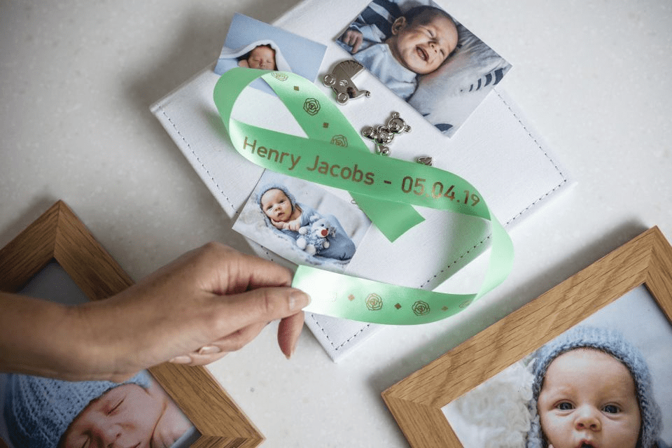 Brother TZe-RM54 satin ribbon tape cassette - gold on mint green - new born baby photo album with the name and date of birth of the baby