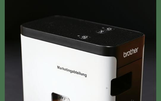 Casetă cu bandă de etichete originală Brother TZe-S121 – negru pe transparent, lățime de 9mm 4