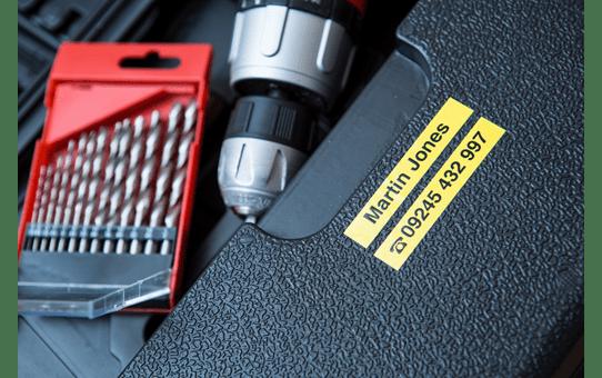 Casetă cu bandă de etichete originală Brother TZe-S621 – negru pe galben, lățime de 9mm 4