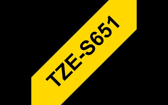 Original Brother TZeS651 merketape - sort på gul med sterkt lim, 24 mm bred