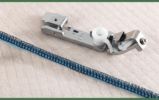 Лапка для пристрачивания тесьмы SA212