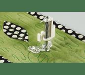 Pied pour quilting ouvert sur tissu avec stippling en mouvement libre