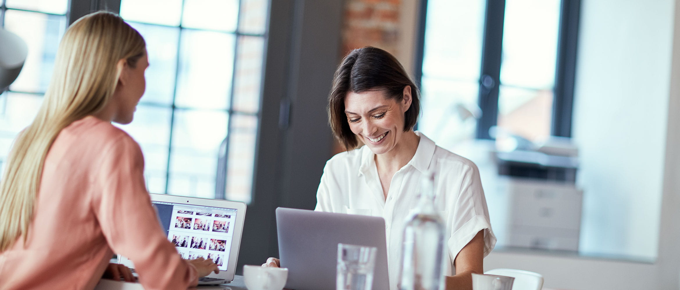 A woman sitting at her desk using her laptop